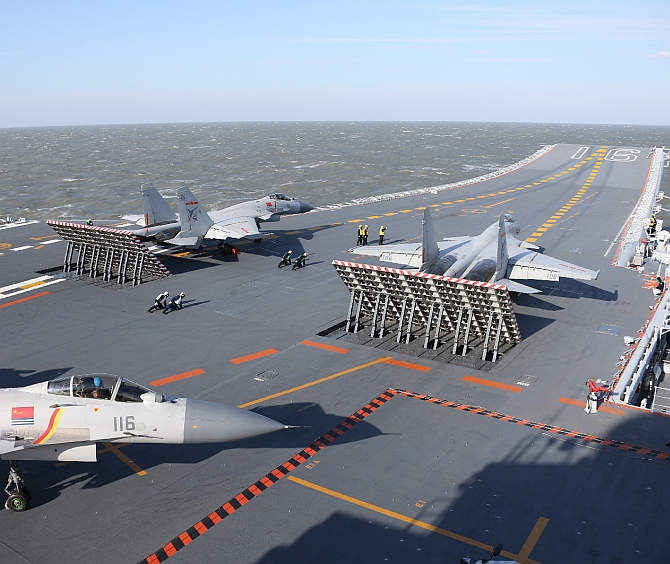 Fighter drills by China's aircraft carrier