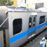 Man jumping through window-train catches speed